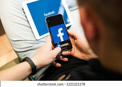 Moldova, Hincesti, 29.10.2018. Man liked the facebook profile image on Iphone X. Iphone x Black. Facebook social networking app.