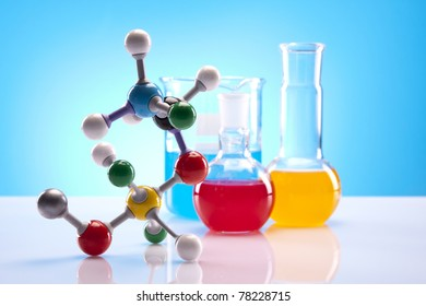 Molecular model and flasks in laboratory