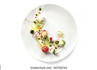 Molecular modern cuisine vegetable salad. Stock image. Isolated on white.