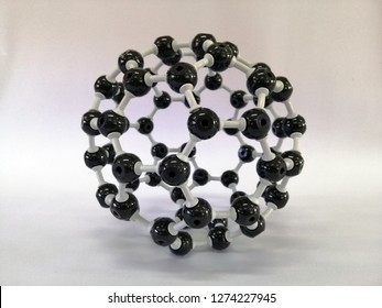 Molecular structure model of Buckminsterfullerence, Buckminsterfullerene is a type of fullerene with the formula C60.  Buckminsterfullerene model