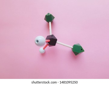 Molecular structure model of Dichloromethane molecule. Dichloromethane (DCM or methylene chloride) is an organic compound with the formula CH2Cl2. Black=C, green=Cl, white=H.