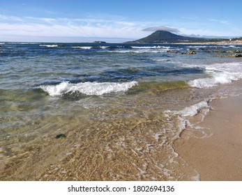 Moledo beach shoreline in the afternoon.
