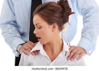 Molestation at work concept. Man molesting woman