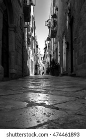 Molfetta, Puglia, Italy, august 2016: view of characteristic street in old town.