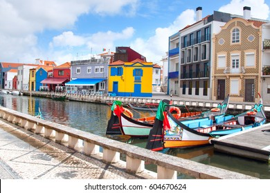 Moliceiro boats docked along the central canal in Aveiro, Portugal