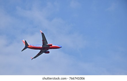 MOLINE, ILLINOIS - SEPTEMBER 1, 2017: Southwest Airlines commercial jet isolated in a blue sky over Moline, Illinois