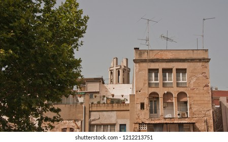 Molins de Rei, Baix Llobregat. Street of the old town, old buildings with the view of the bell tower of the church in the background. Catalunya Spain.