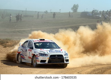 MOLLERUSSA, SAPIN - AUG 31: Spanish driver Xevi Pons and his codriver Xavier Amigo in a Mitsubishi Lancer Evo X race in the 4th Rally Pla d'Urgell, on Aug 31, 2013 in Mollerussa, Spain.