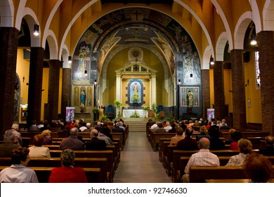 MOLLET, SPAIN - MAY, 1: Unidentified people attend mass in Sant Vicenç church during the National Worker Day, on May 1, 2011, in Mollet del Valles, Spain.
