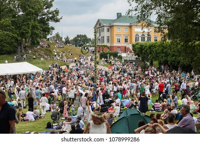 MOLNDAL, SWEDEN - JUNE 24, 2016: A large crowd has gathered to celebrate midsummer at Gunnebo castle. Midsummer is the biggest traditional holiday in Sweden.