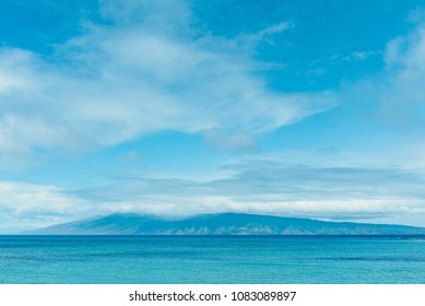 Molokai And The Pailolo Channel As Seen From Kapalua Beach On The Island Of Maui