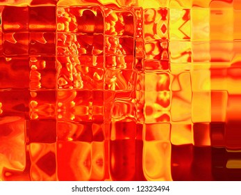 Molten abstract art of sugar candy in brilliant red, orange and yellow colors.