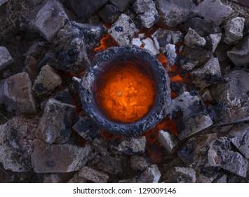Molten bronze in a crucible awaits casting
