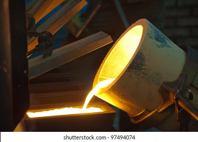 Molten Gold being poured into Ingot moulds