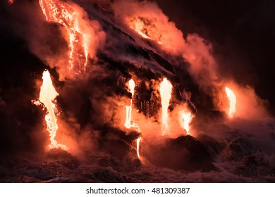 Molten lava flowing into the Pacific Ocean on Big Island of Hawaii at dawn