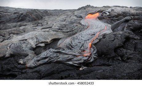 Molten magma breaking through the ground of the lava fields of Puu Oo, Big Island, Hawaii.