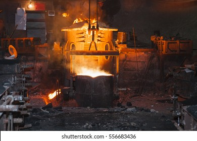 Molten metal. Left over material from the steel manufacturing process is poured away on at a Steel Foundry