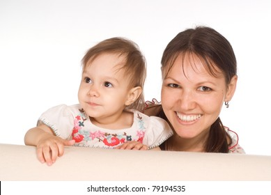 mom and baby behind the sofa on white