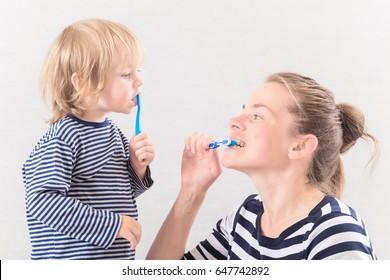 Mom with baby brushing teeth