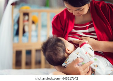 Mom and baby feed a milk by nature