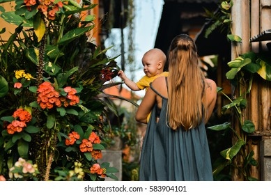 Mom and a baby in the garden, Bali, Indonesia