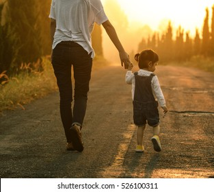 Mom and baby happy walk at sunset, The concept of a happy family