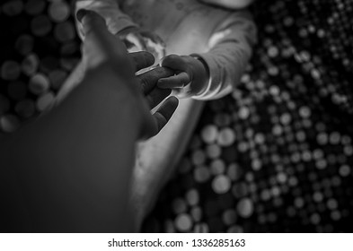 mom and baby hold hands