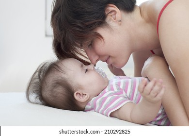 Mom and baby lying on the bed