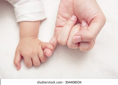 Mom and Baby making a pinkie promise, New family and baby protection concept