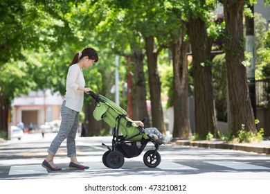 mom and baby taking a walk