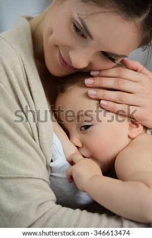 Mom breast feeding baby girl