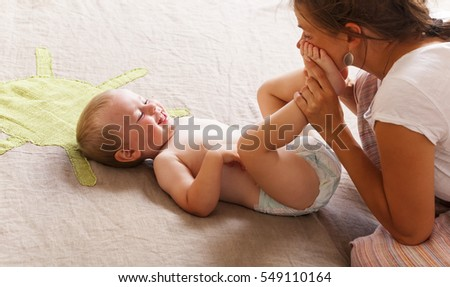 mom change play son baby diaper