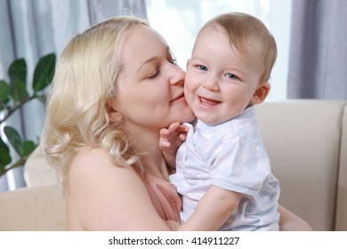 Mom with a child in the bright room, hugging
