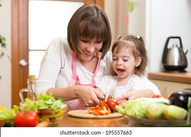 mom and child cooking at kitchen