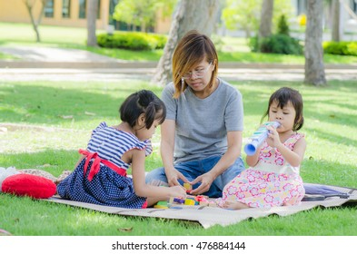 Mom And Child Play a toy in the park