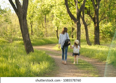 Mom and child are strolling along the spring park. mothers Day
