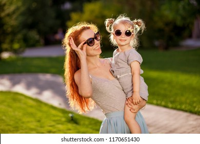mom with a child with sunglasses
