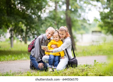 Mom with children doing selfie in nature