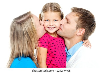 Mom and dad kissing their beautiful kid on cheeks from both the sides