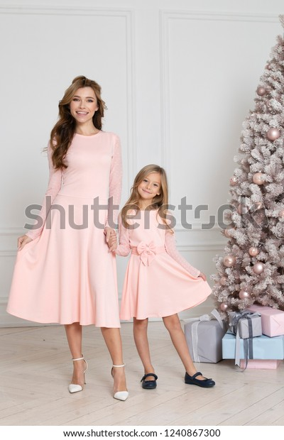 Christmas Presents For Mom From Daughter.Mom Daughter Celebrating Christmas Standing Near Stock Photo