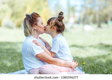 Mom and daughter are chatting outdoors