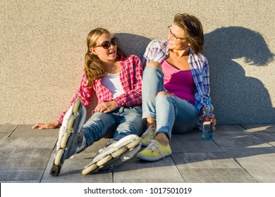 Mom and daughter. Communication and Parental Care. Portrait of mother and daughter relaxing outdoors