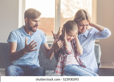 Mom and daughter are covering ears while angry father is yelling at them