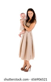 Mom and daughter dresses in beige on a white background