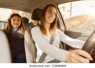 Mom and daughter going to the school in the car