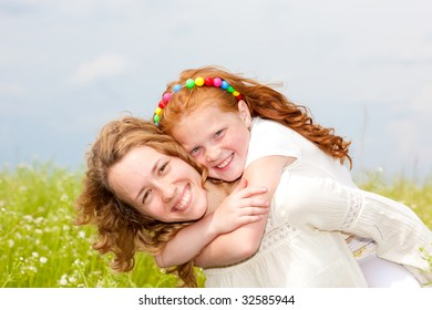 Mom and Daughter Having Fun in the field. Focus on eyes.