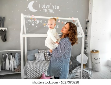 Mom and daughter are at home in the room, Mother's Day.