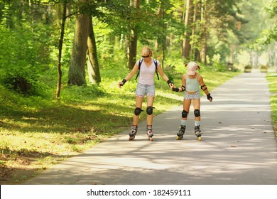Mom and daughter learn to roller skate