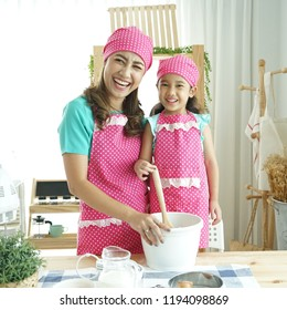 mom an daughter make bakery in the kitchen room