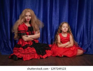 mom and daughter are offended and sitting on the floor. mom is trying to establish peace and friendship with the child.